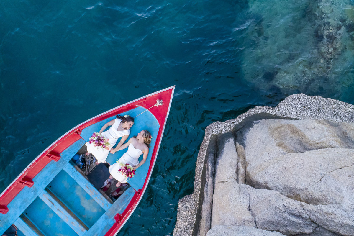 Two brides on a longtail boat in Koh Tao, Thailand