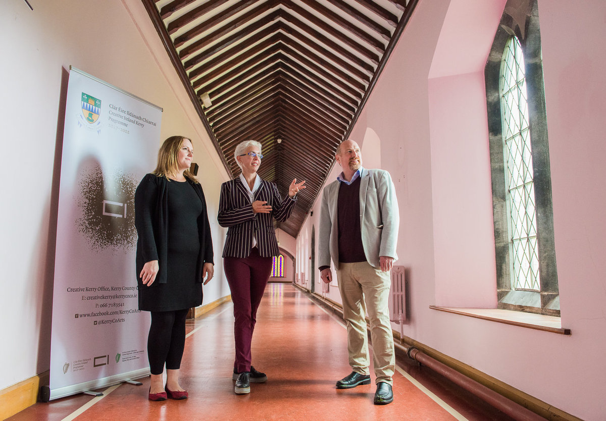 Architects standing in hallway of building with church ceiling