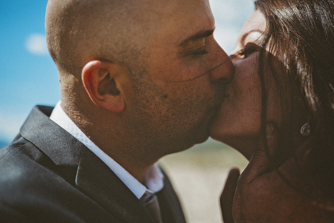 Bride and Groom Kissing in wedding photography Valemount BC
