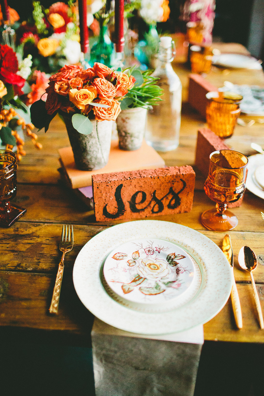 Vintage plate table setting with gold cutlery and hand painted brick name card for casual fall inspired dinner party with Local Table