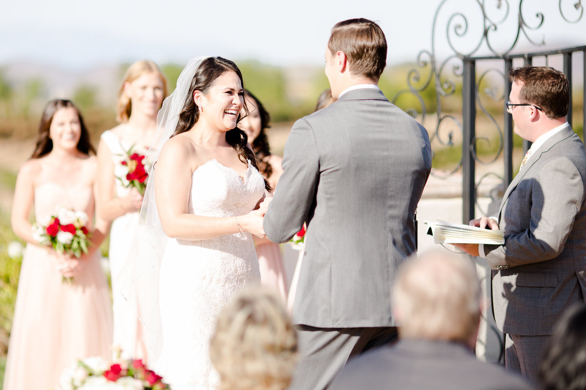 Bride laughs during her wedding ceremony at villa de amore by matty fran photography