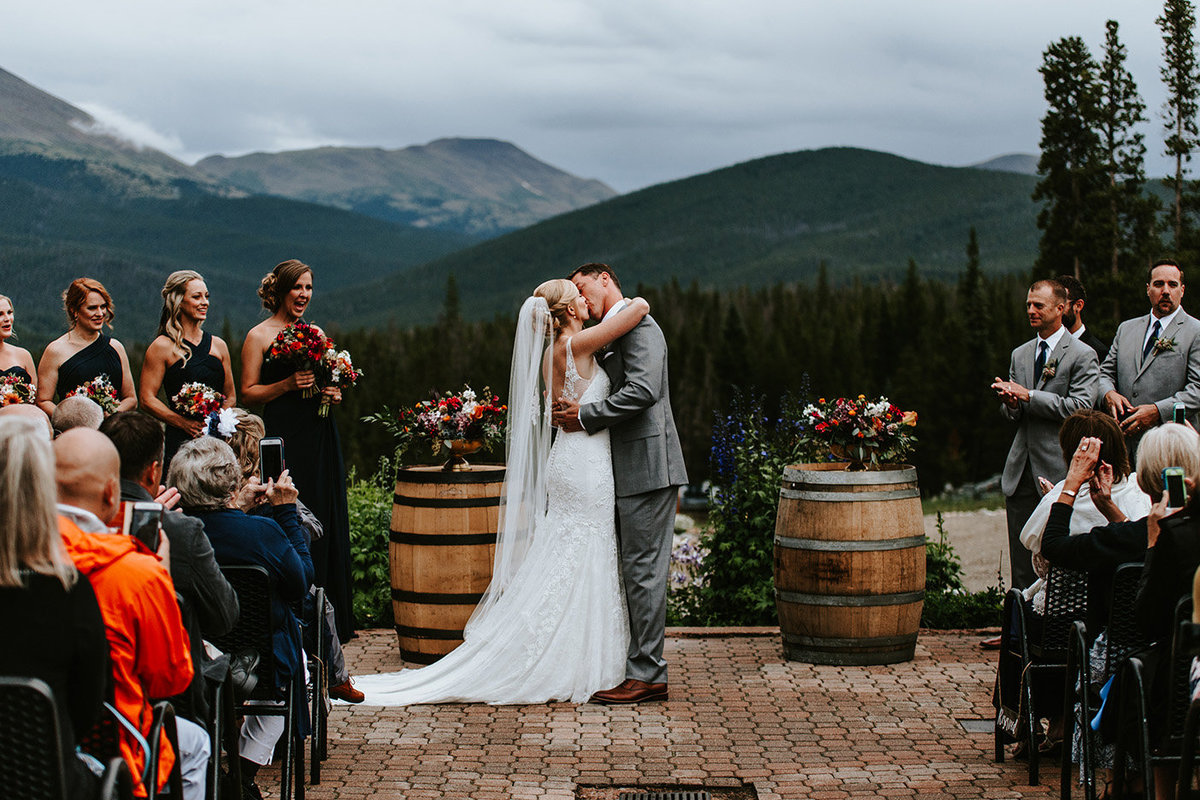 first kiss as a married couple at Ten Mile Station in Breckenridge Colorado