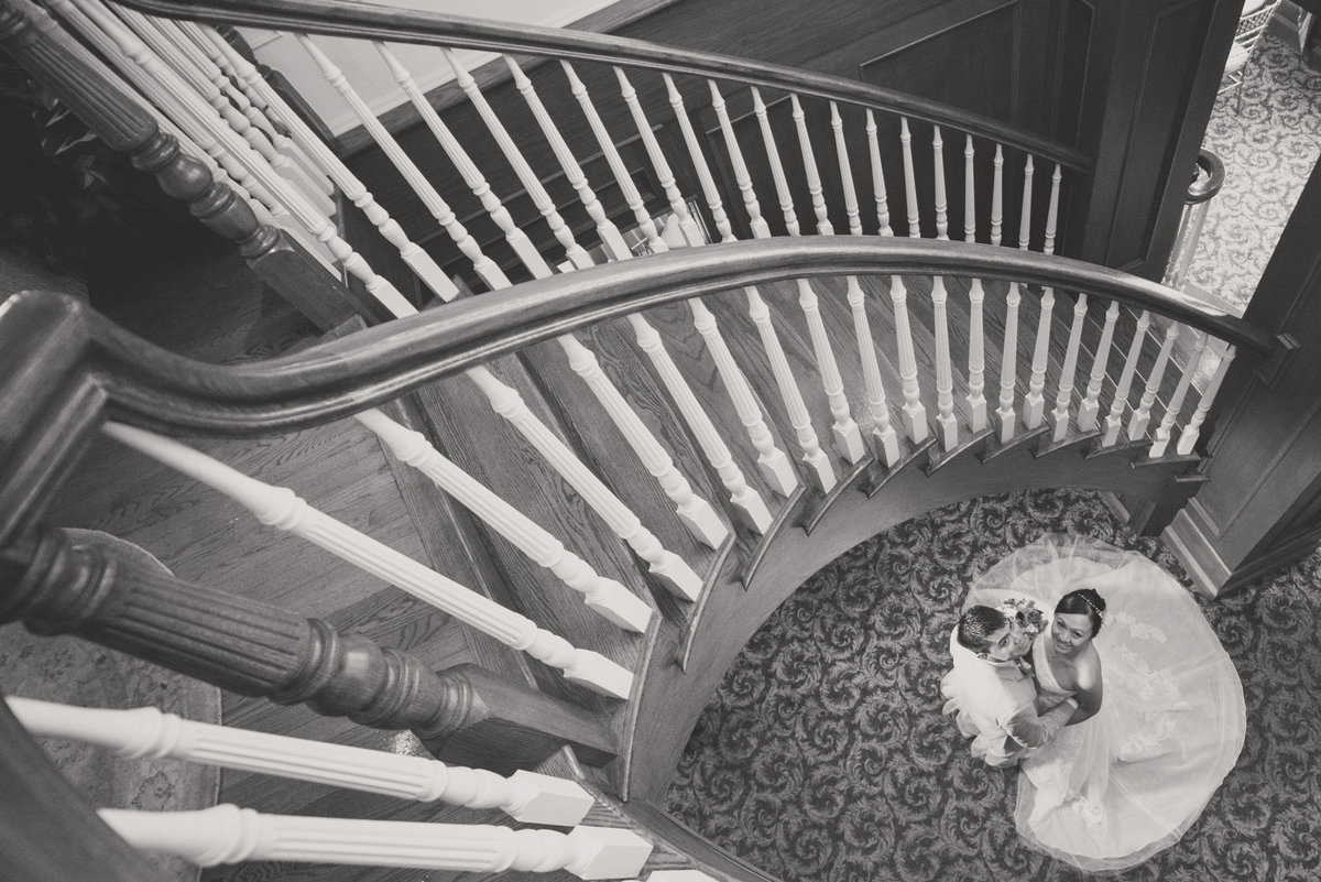 Bride and groom portrait at the staircase of Bridgeview Yacht Club