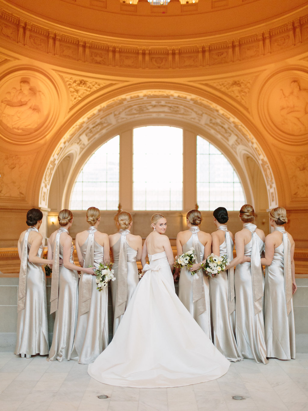 Bridesmaids for wedding by Jenny Schneider Events at the San Francisco City Hall. Photo by Larissa Cleveland Photography.