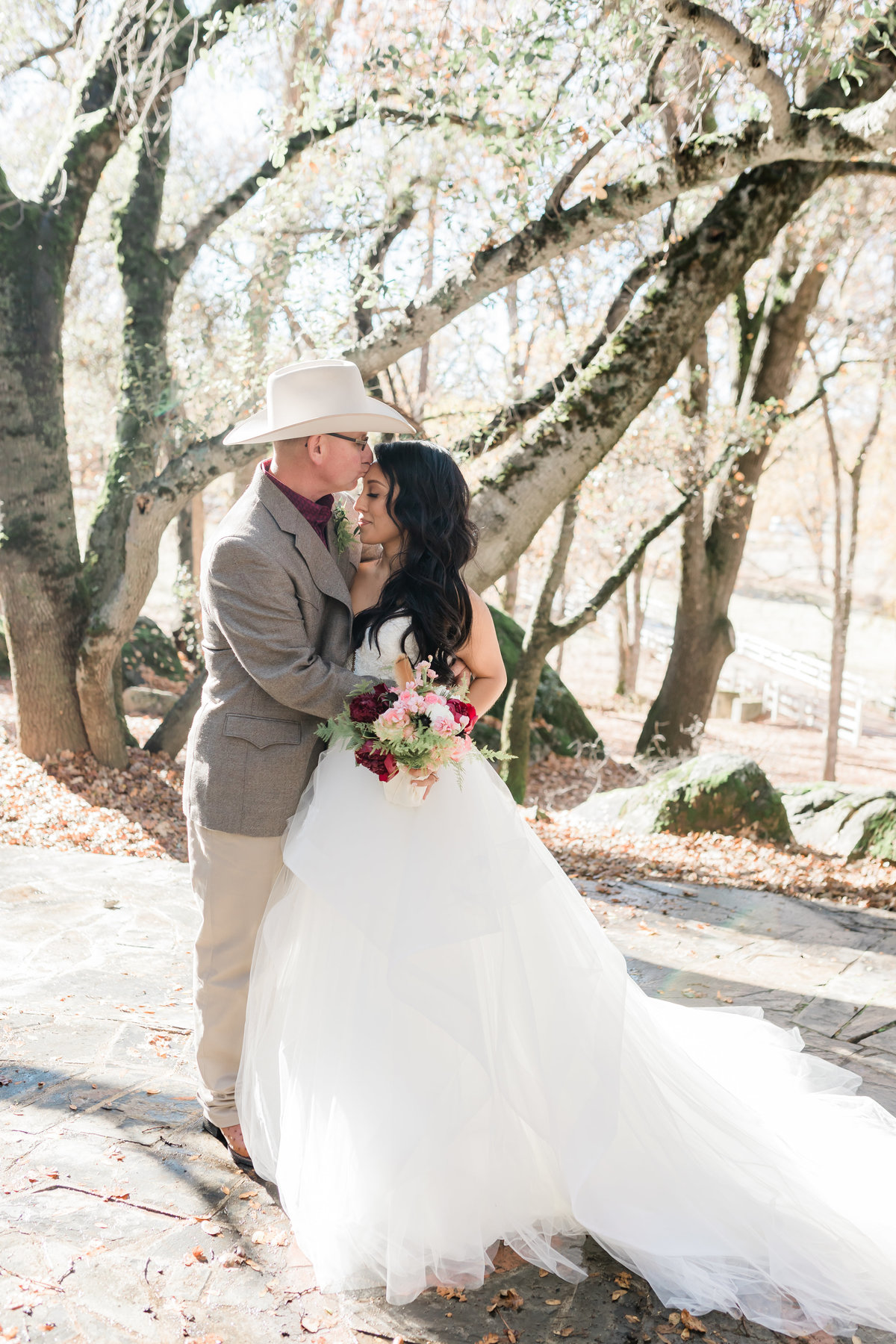 Gina and Garret eloped near Yosemite for their wedding ceremony and had their photos taken in the forest.