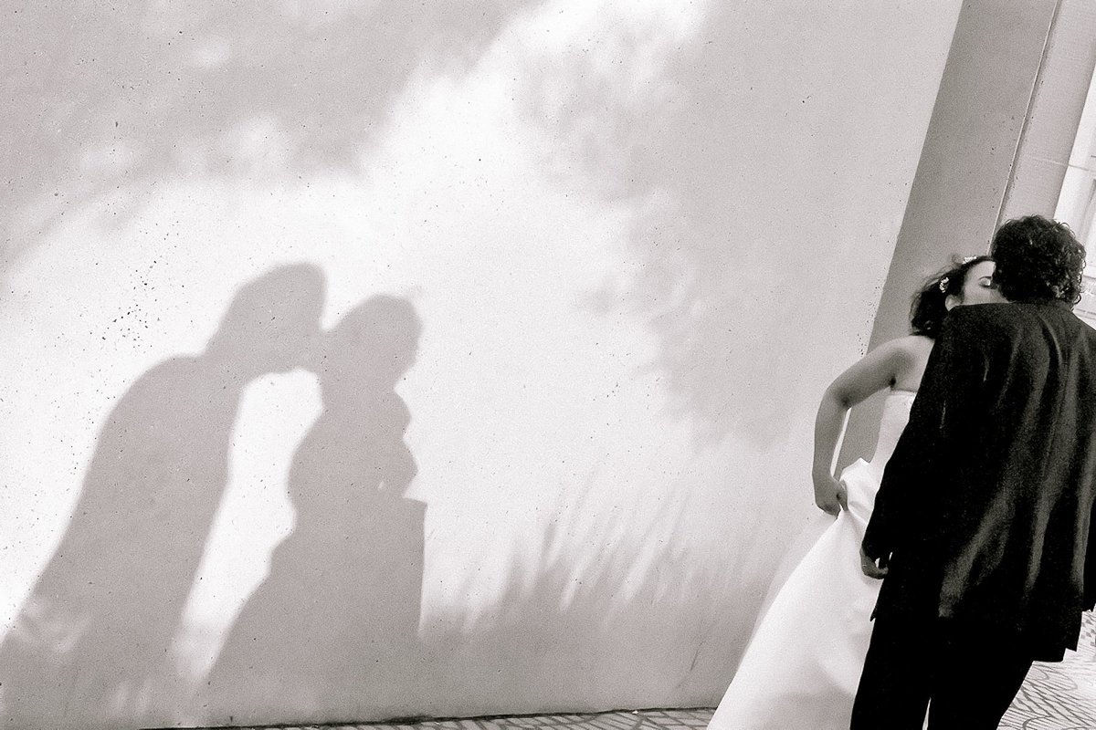 A bride and groom and their shadow at a San Francisco wedding.