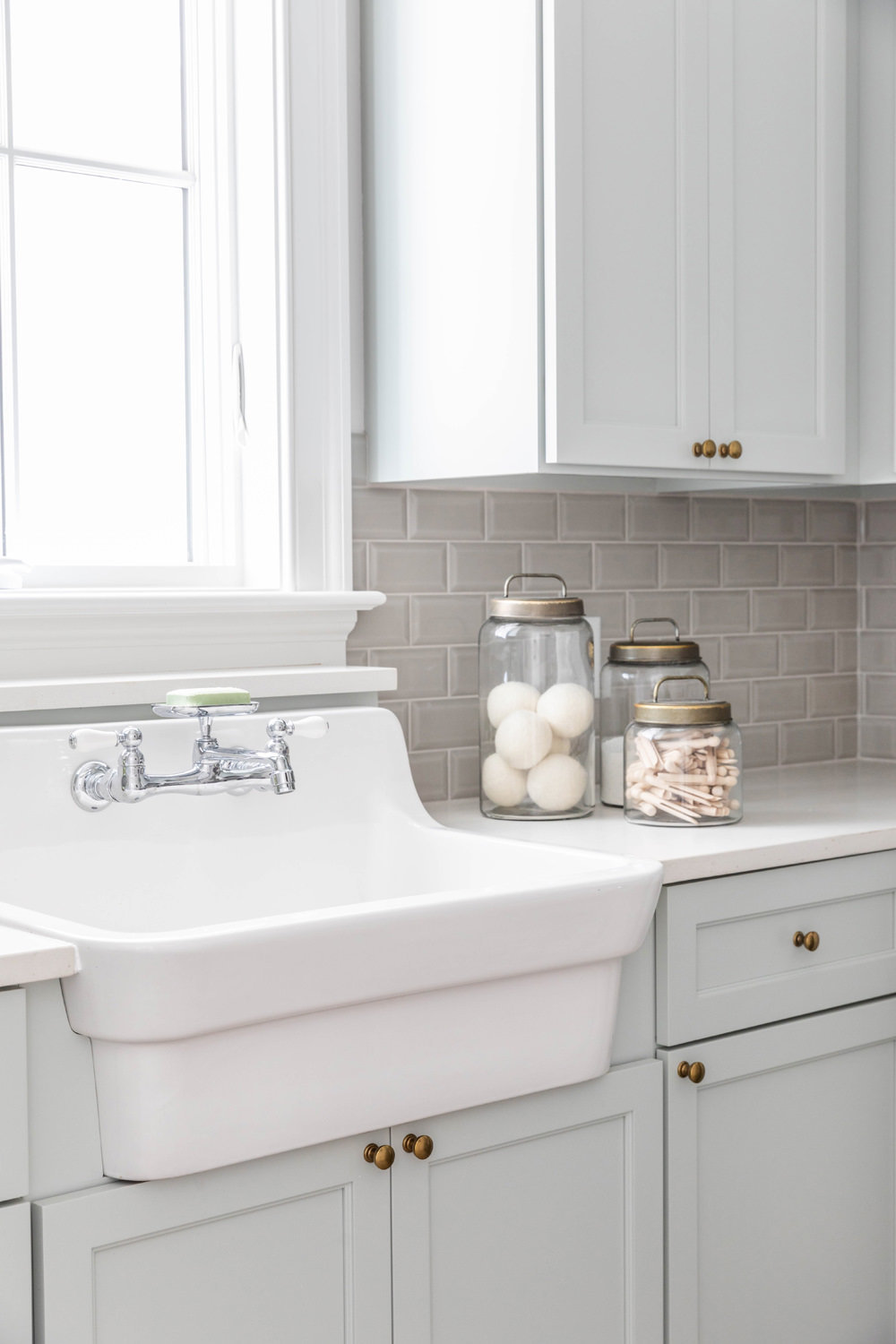 Sherwin-Williams-Silver-Strand-Laundry-Room-with-Kohler-Utility-Sink-and-Brick-Herringbone-Floor-4