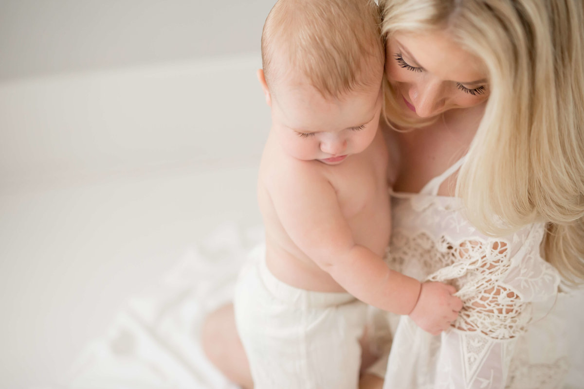 mother and baby cuddling in a houston photography studio