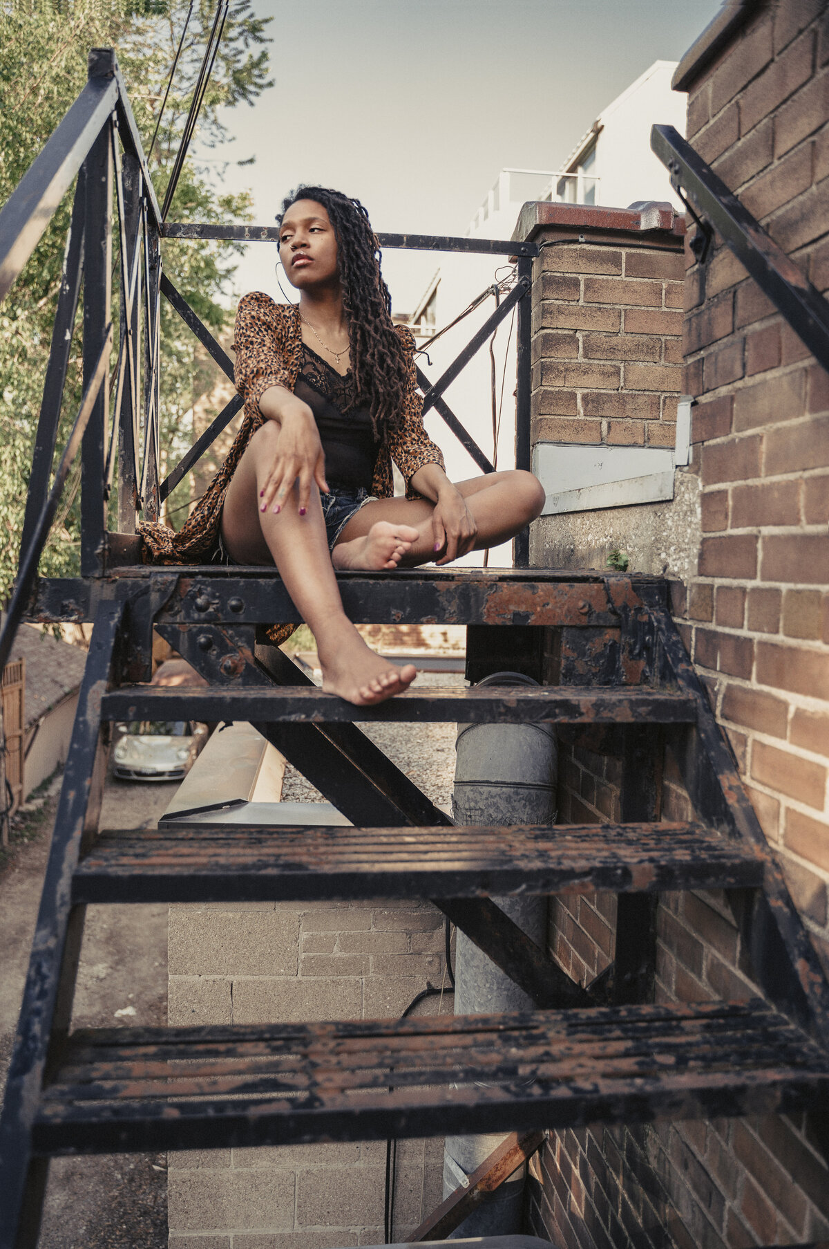 black woman posing on stairs