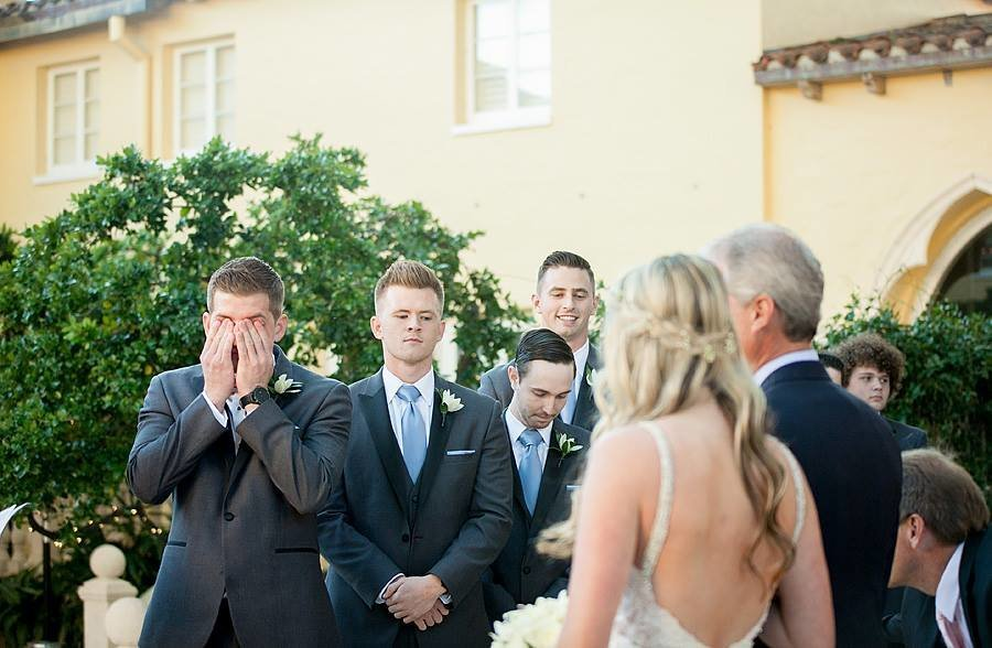 groom crying as bride comes down aisle