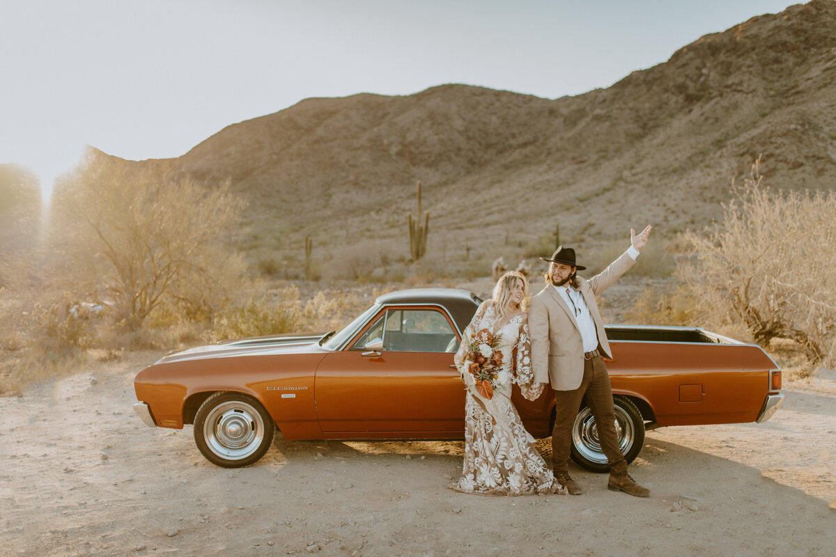 bride and groom celebrating in desert outside of Phoenix