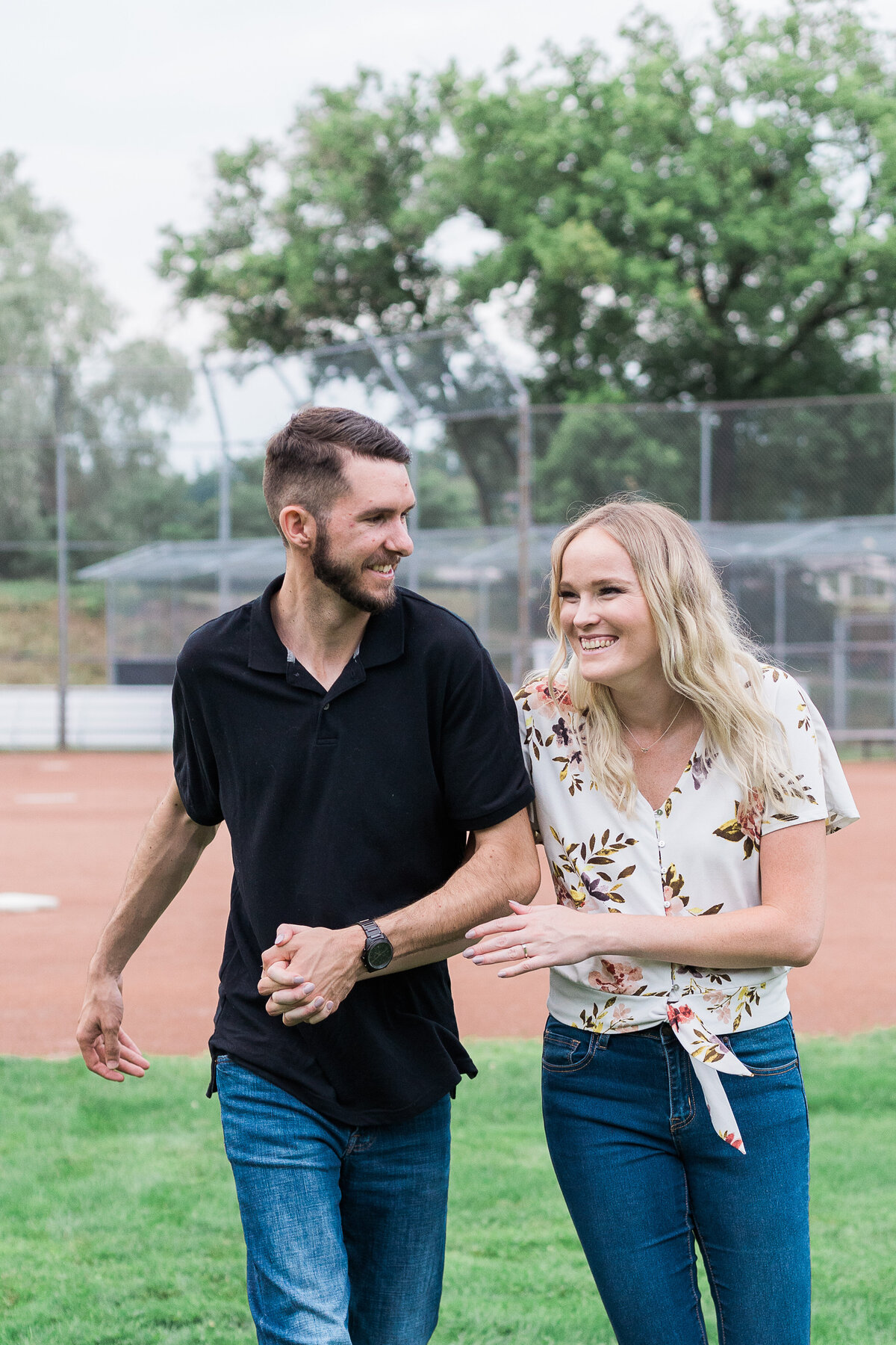 couple laughing together in engagement photo