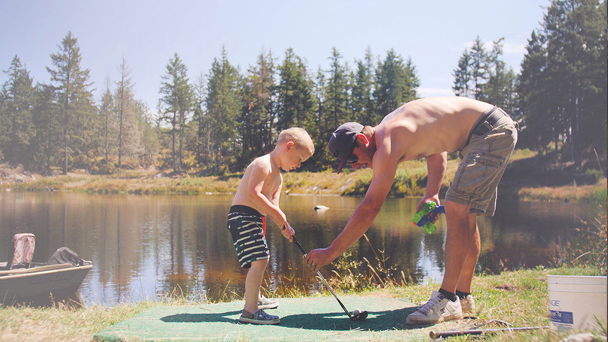 Father-and-Son-Golfing-Lesson