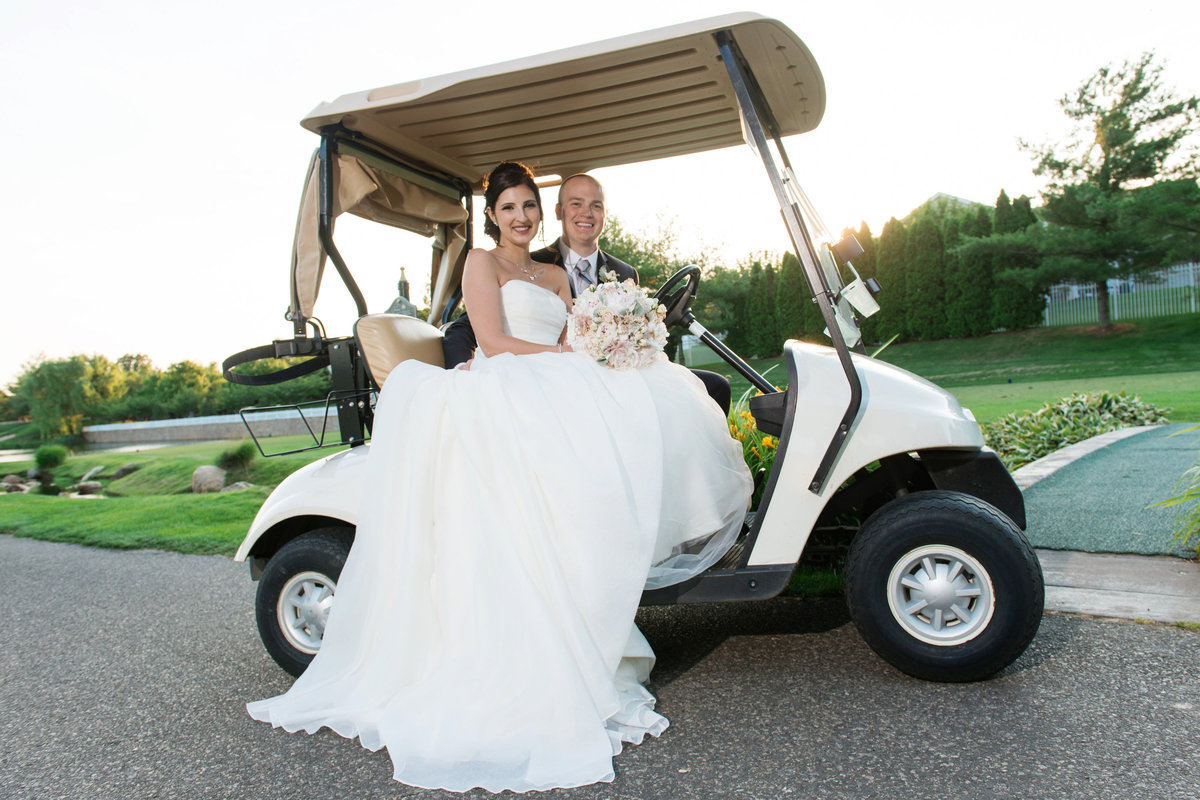 bride and groom on golf cart outside Willow Creek Golf and Country Club