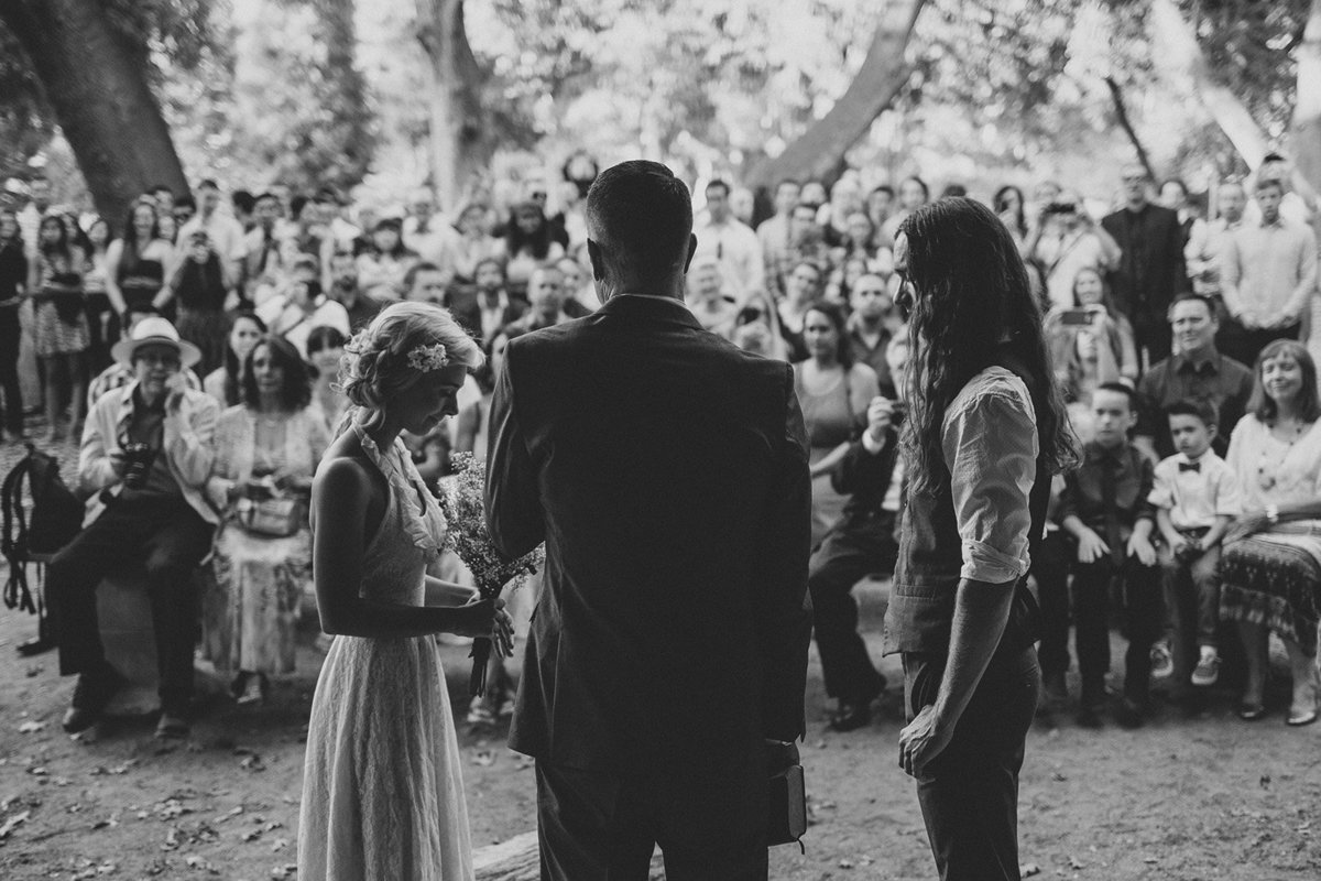 Bride & groom recite their vows during their Oak Glen wedding ceremony in Oak Glen, Ca.