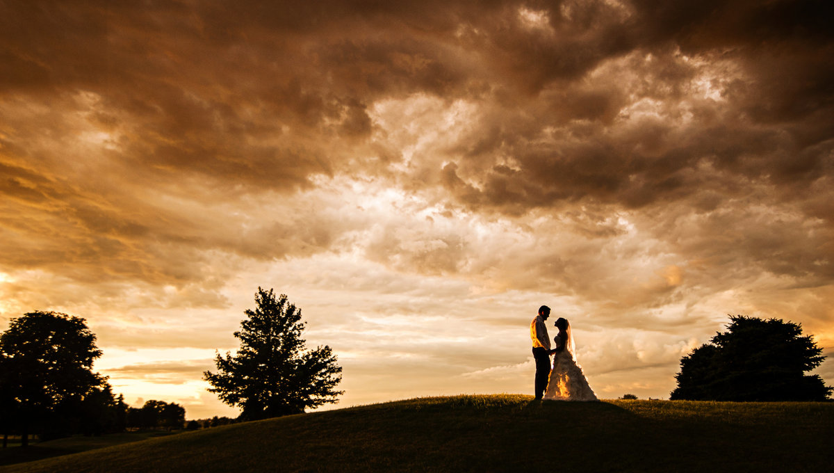 Bride and groom captured a moment between rain drops during their reception in Champaign, Illinois.