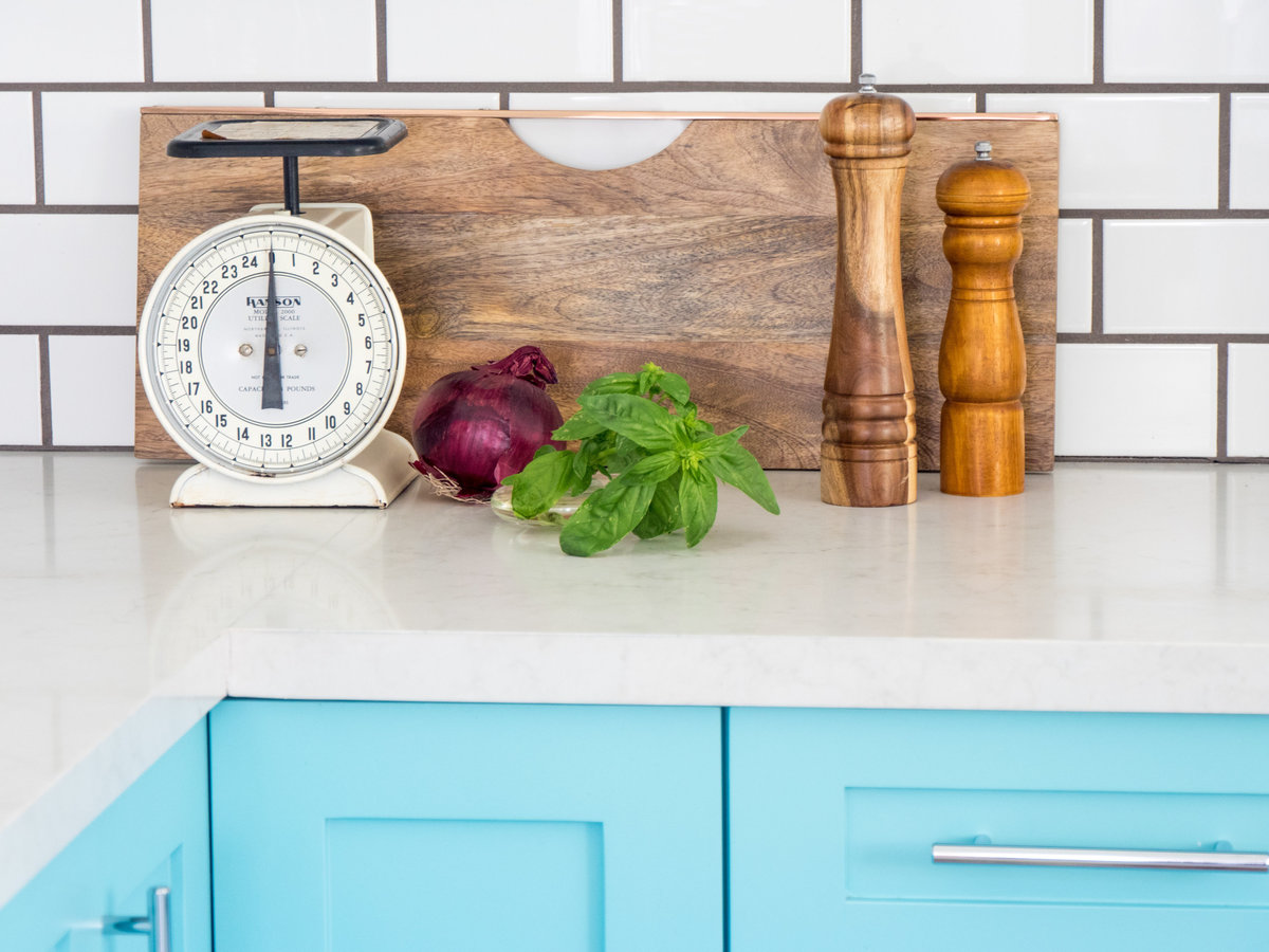 Kitchen interior design with blue lowers and white subway tile