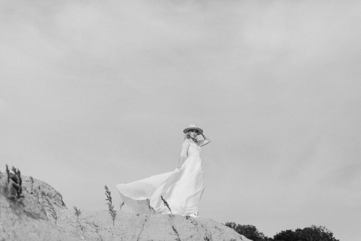 bride on mountain with dress  flowing in the wind