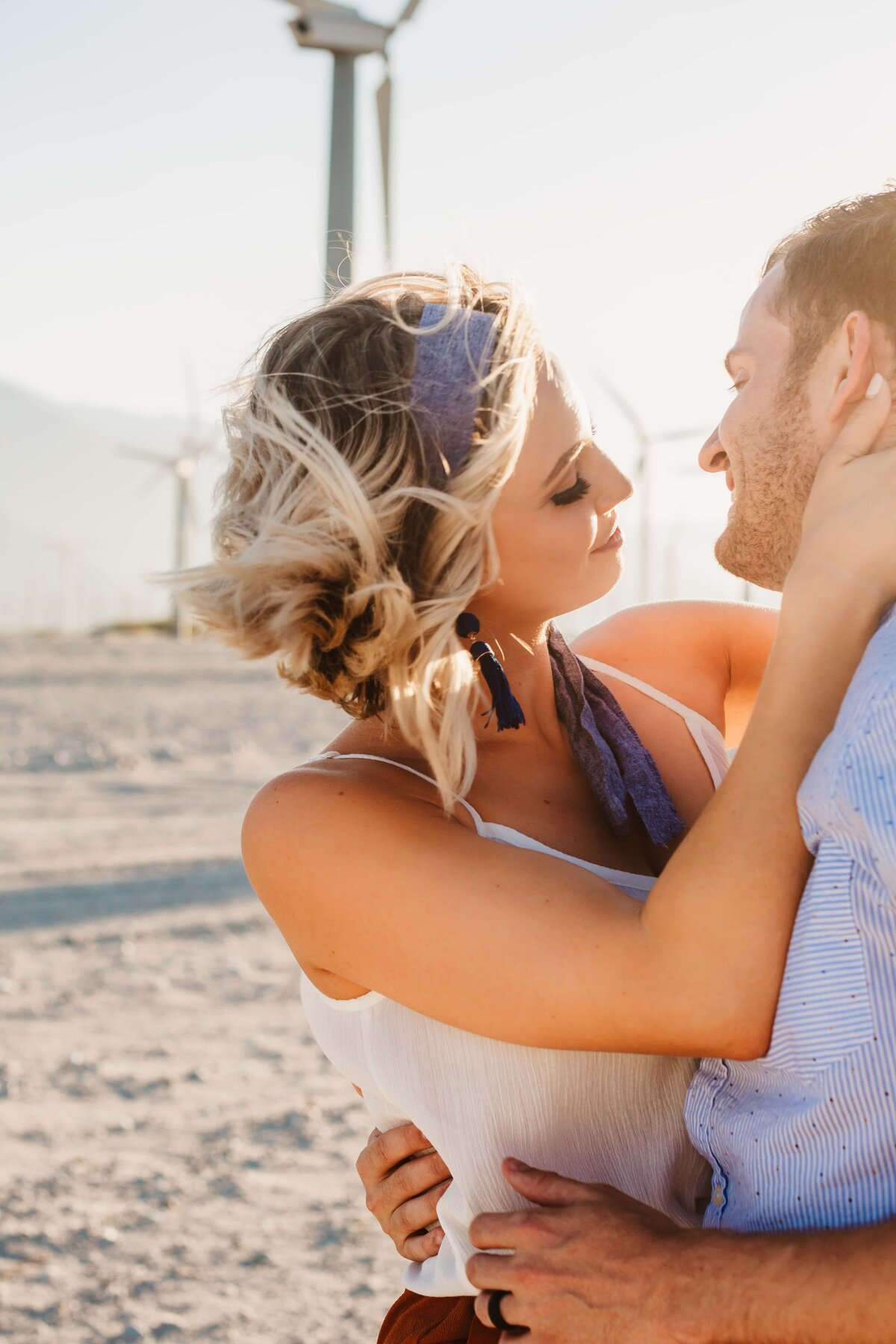 couple-palm-springs-wind-turbines-engagement-shoot