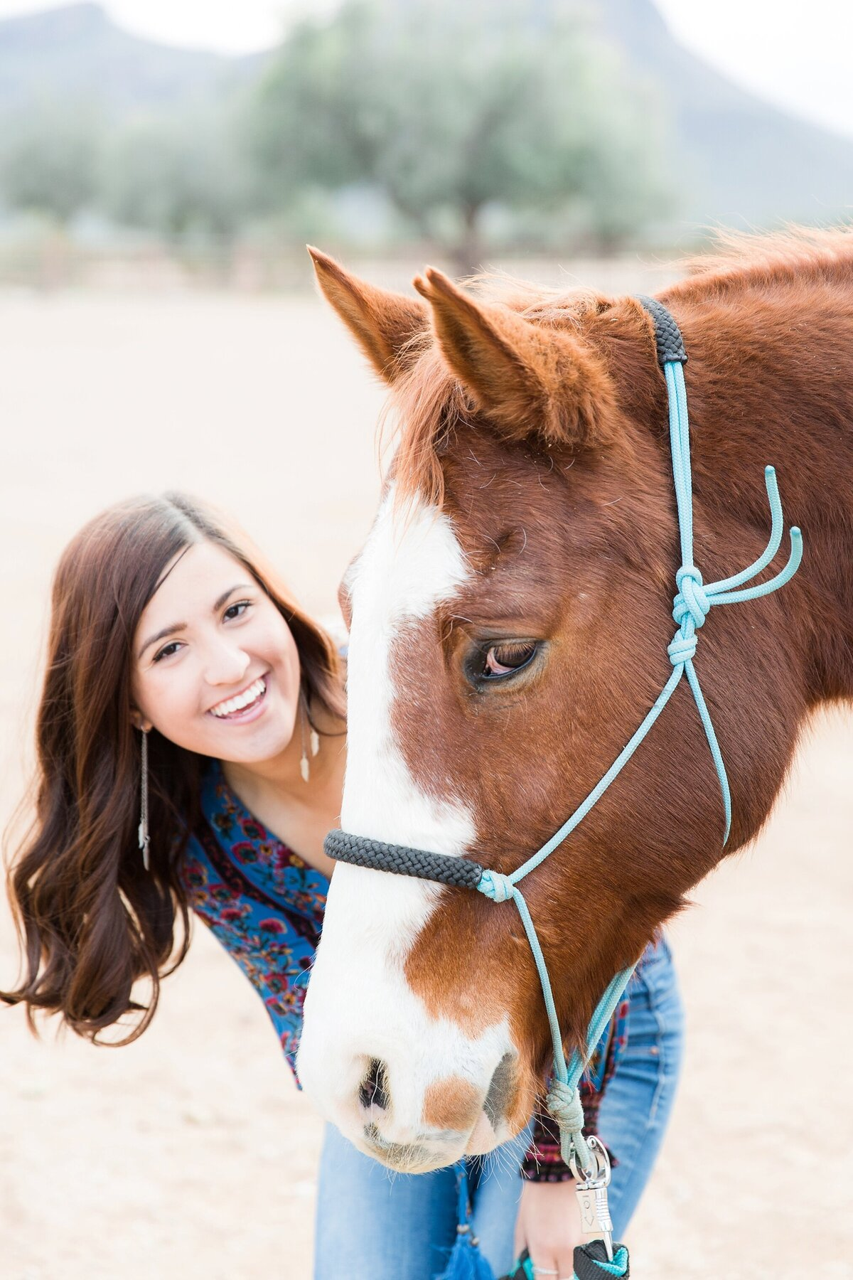 portrait of a girl and her horse, both looking at the camera