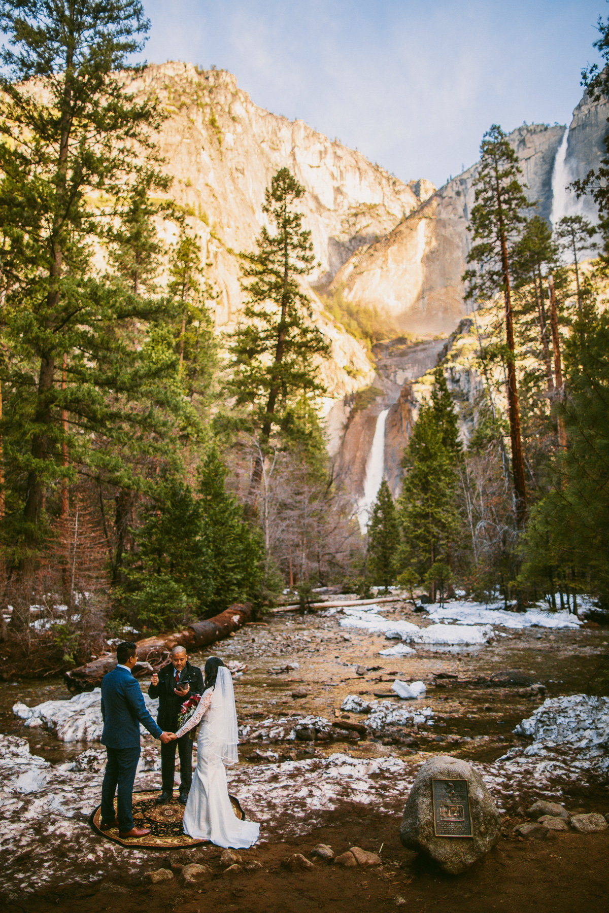 Bride & groom listen to their pastor during their sunrise Yosemite wedding in Yosemite Valley.