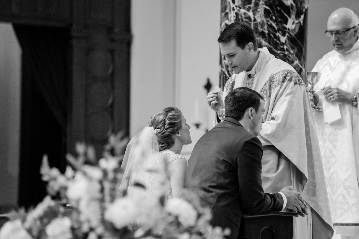 Must have wedding image: Catholic wedding receiving the eucharist at the cathedral