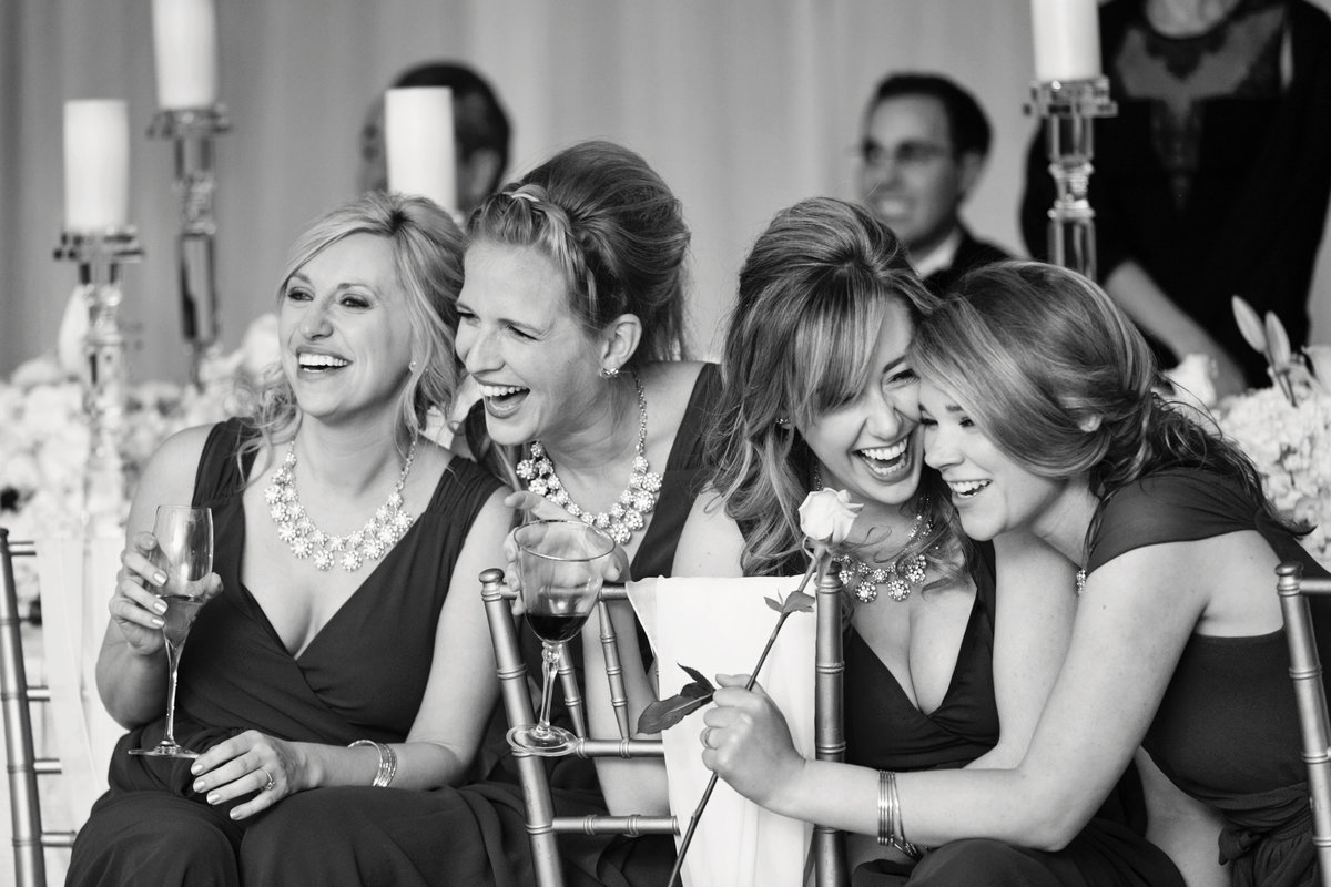 L Photographie Best Wedding Photographers St. Louis wedding toast photos bridesmaids laughing