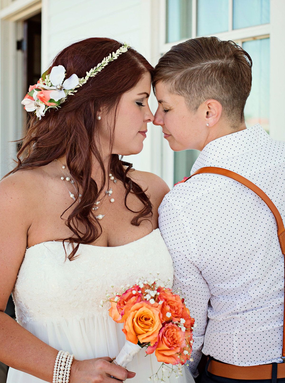 two brides forehead to forehead
