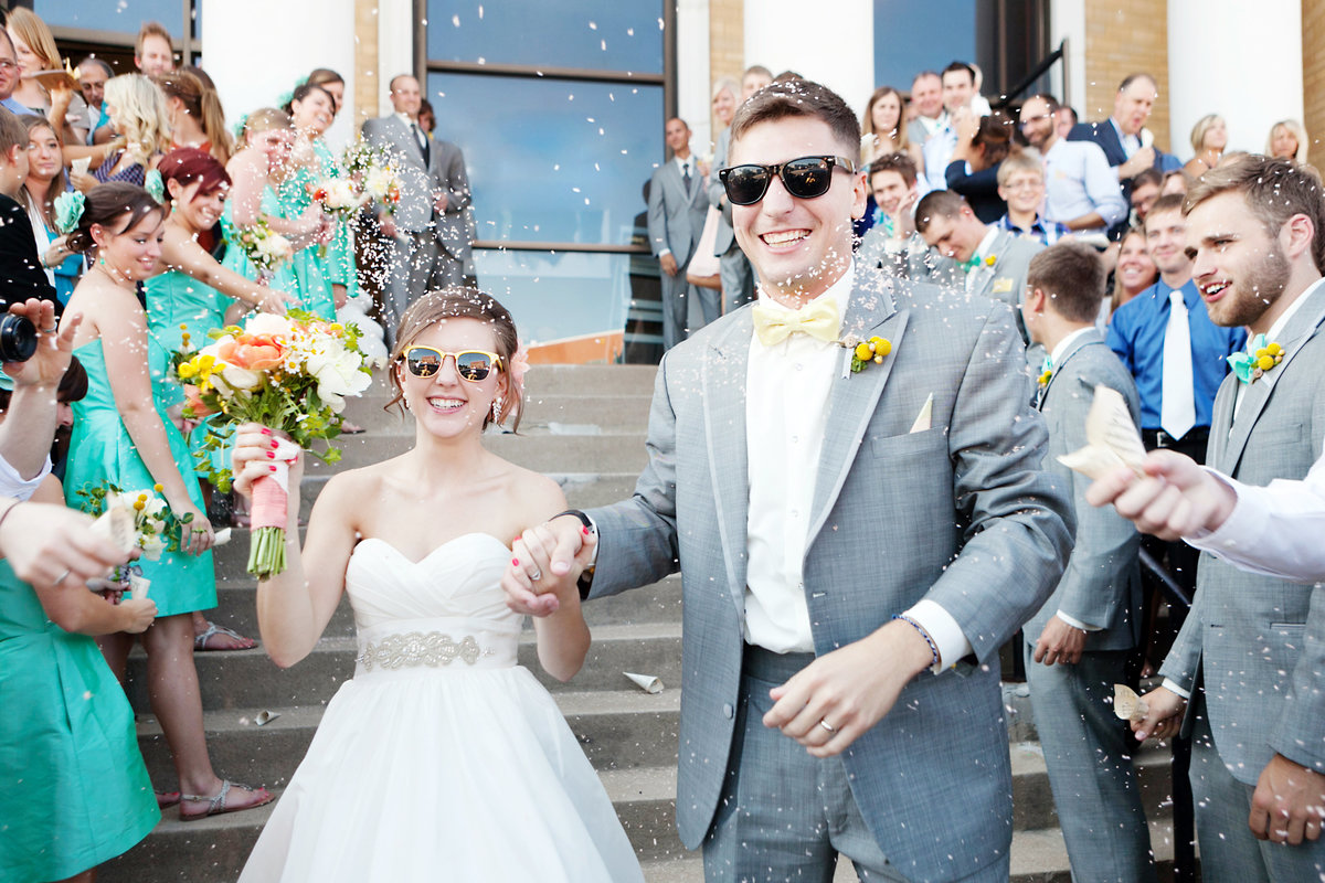 L Photographie Wedding Photographers in St. Louis confetti church exit images