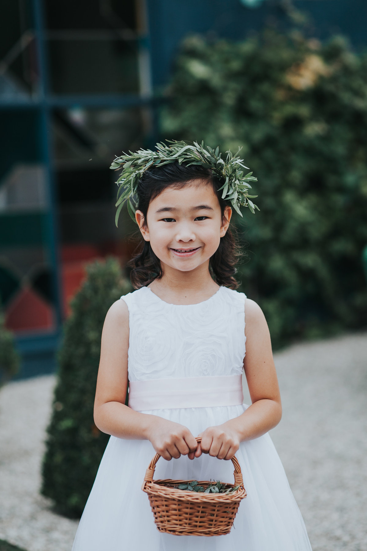 Flower girl with floral crown and eucalyptus leaves at The Fig House wedding in Los Angeles