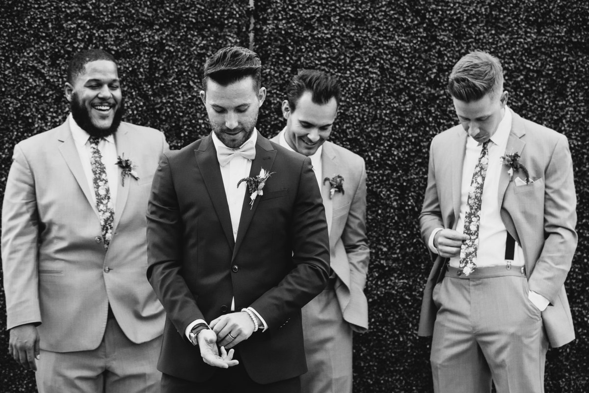 Lake Tahoe wedding photos groom poses with groomsmen