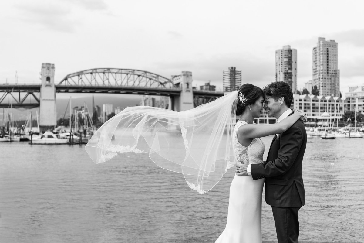 Bridges Restaurant wedding as bride and groom hold each other