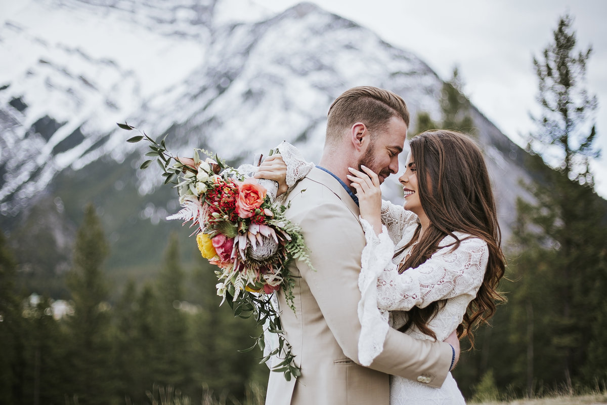 Adventure bride and groom on top of mountain