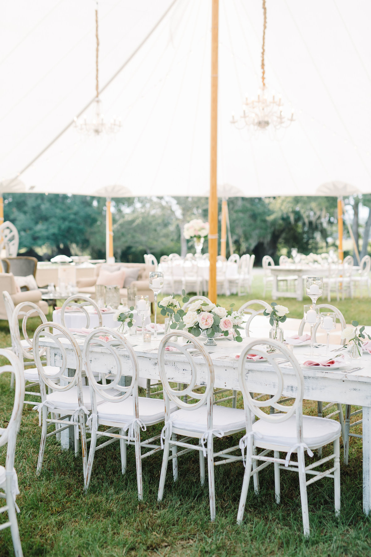 White and Blush Wedding Reception White Chloe Chairs wit Crystal Chandeliers under Sailcloth Tent at Boone Hall