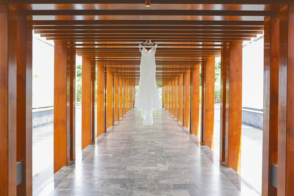 Vera Wang wedding gown hangs from the entryway at the Andaz Resort in Wailea, Maui