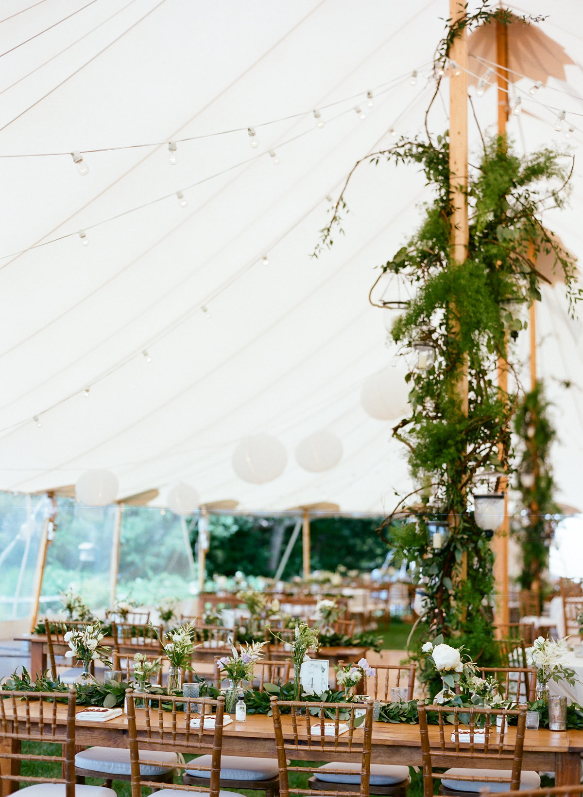 Tented wedding reception decorated tent pole
