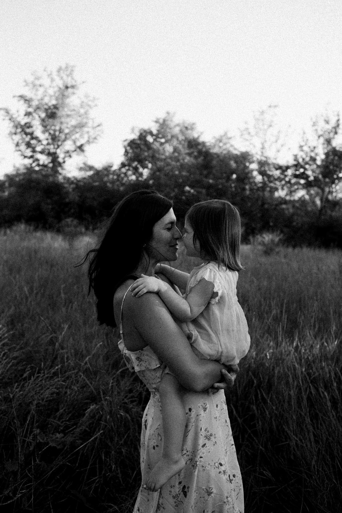 Mom holding daughter during session