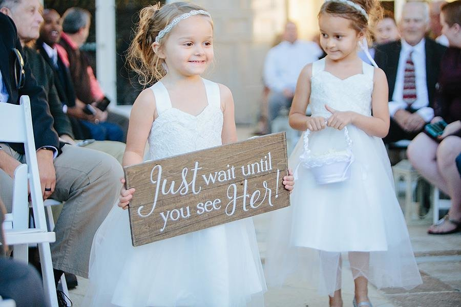 flower girls with signs the addison