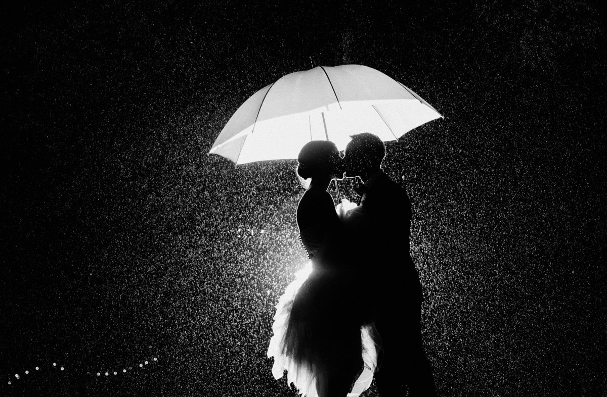 creative rainy day black and white dramatic light kiss wedding bride and groom
