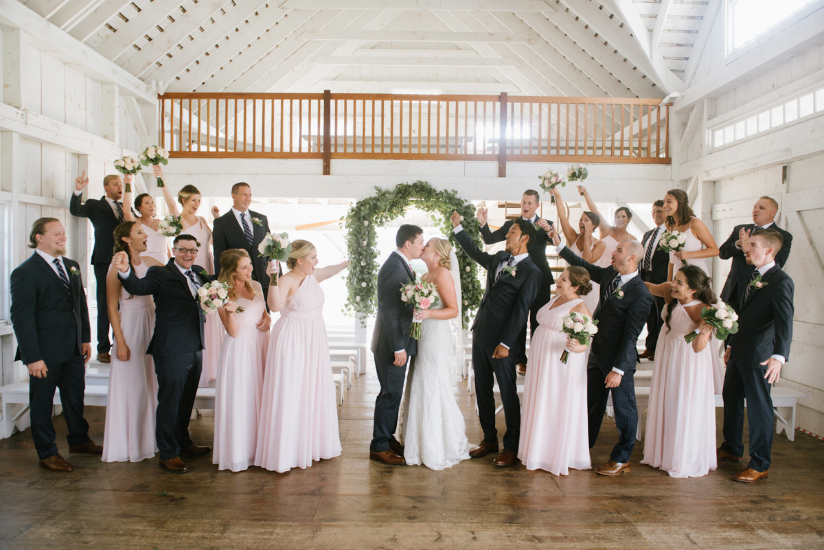 bridal party wearing blush and blue in the chapel at bonnet Island Estate