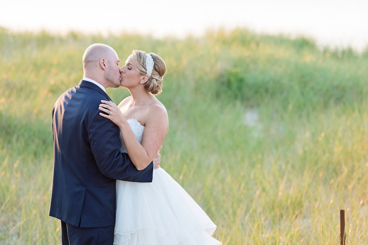 photo of bride and groom kissing at Pavilion at Sunken Meadow wedding
