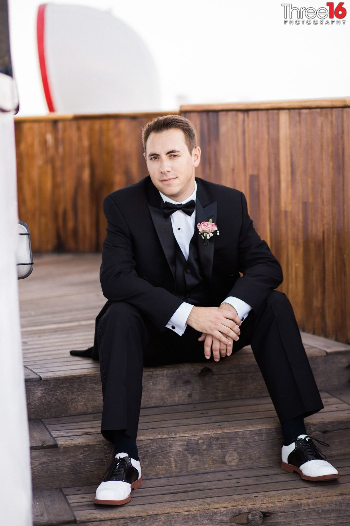 Groom sitting down prior to wedding service