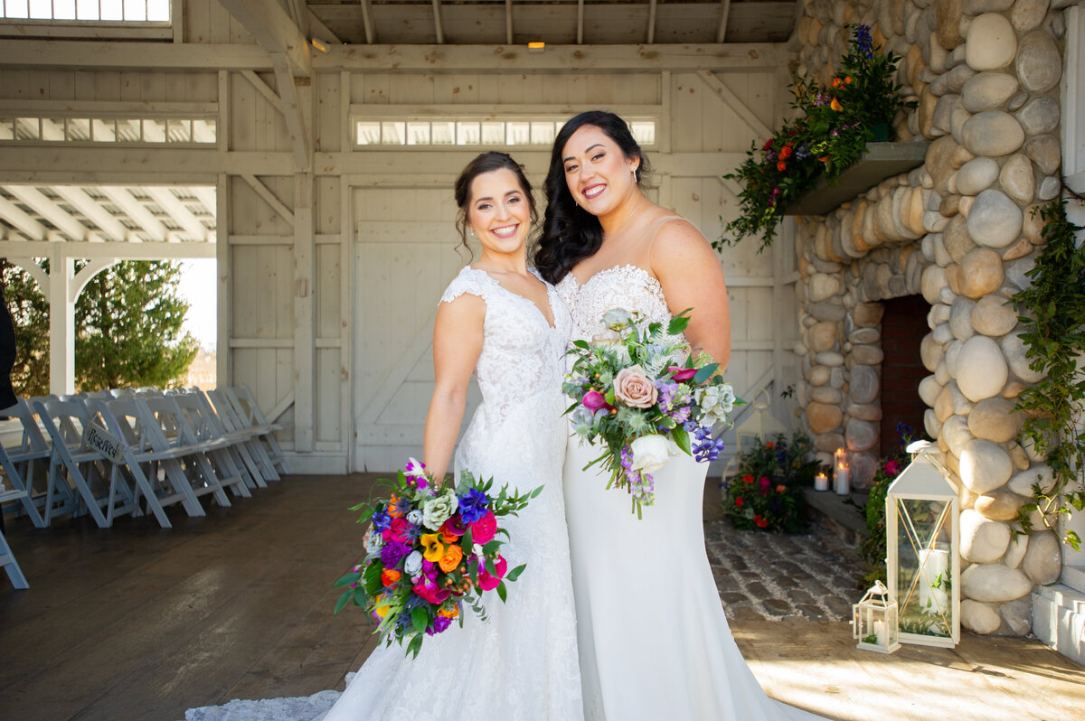 boathouse chapel with lesbian brides and colorful flowers