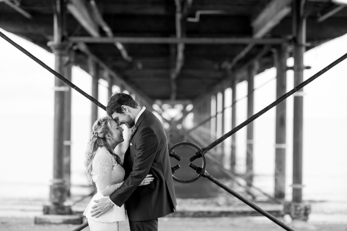 bride-and-groom-under-paignton-pier-devon