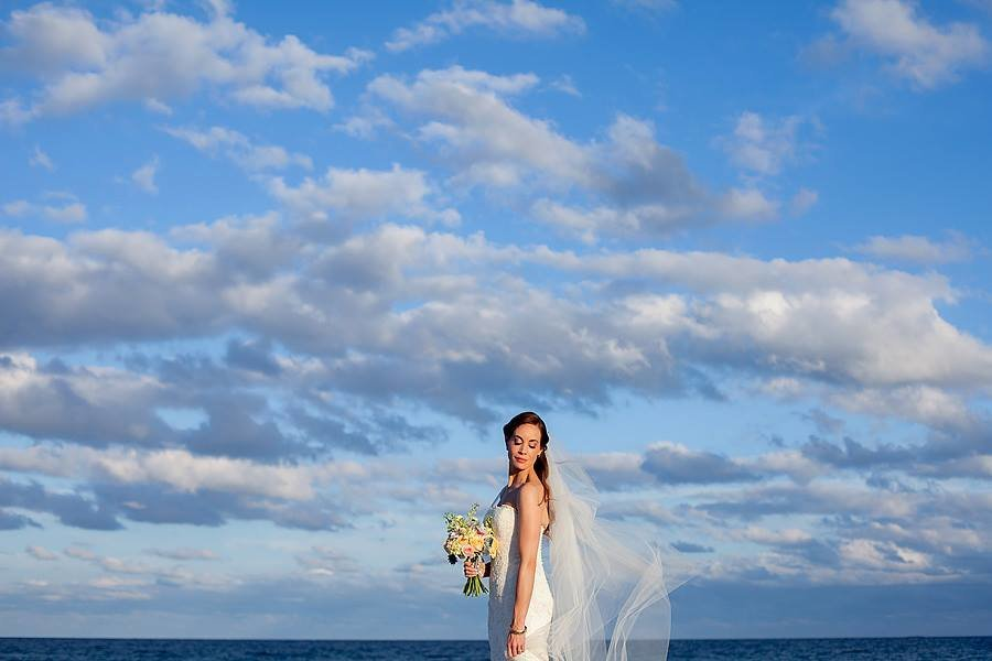 bride with blue sky backdrop