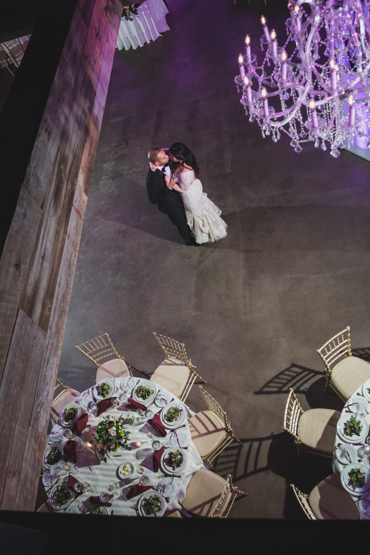 wedding photo of bride and groom dancing and holding each other during reception at The Loft by Bridgeview