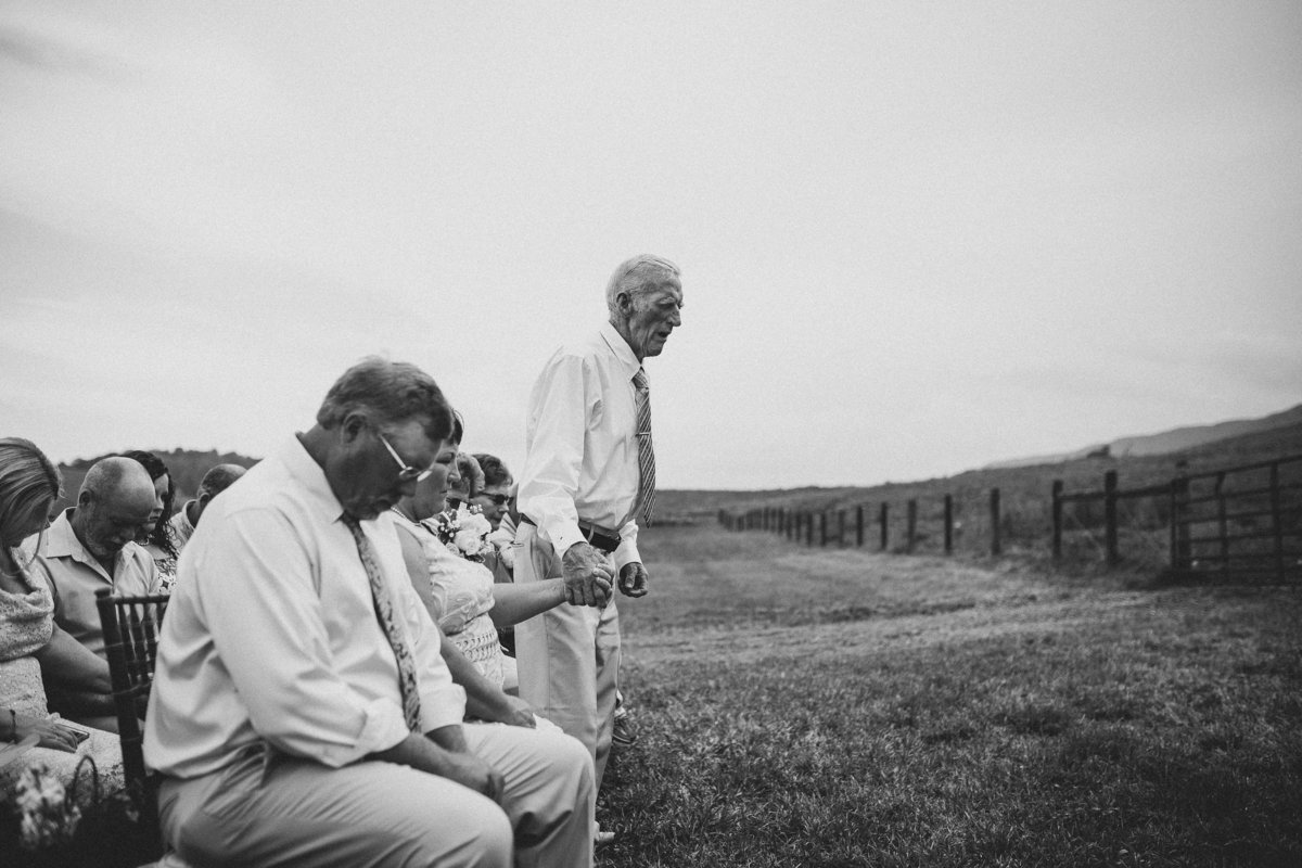 grandfather-praying-farm-wedding
