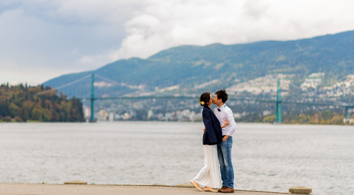 Stanley Park wedding session with Lions Gate bride in the background.