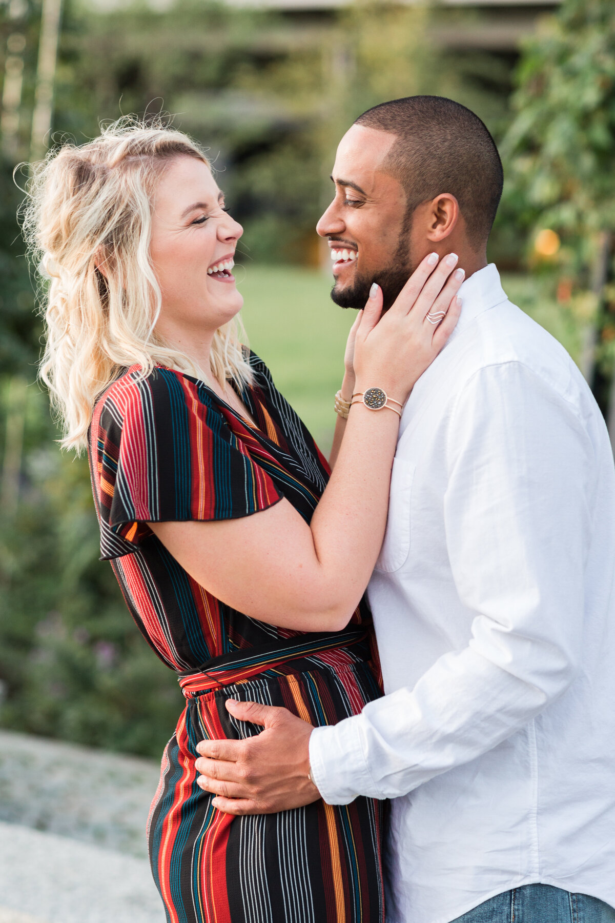 interracial couple laughing during engagement session