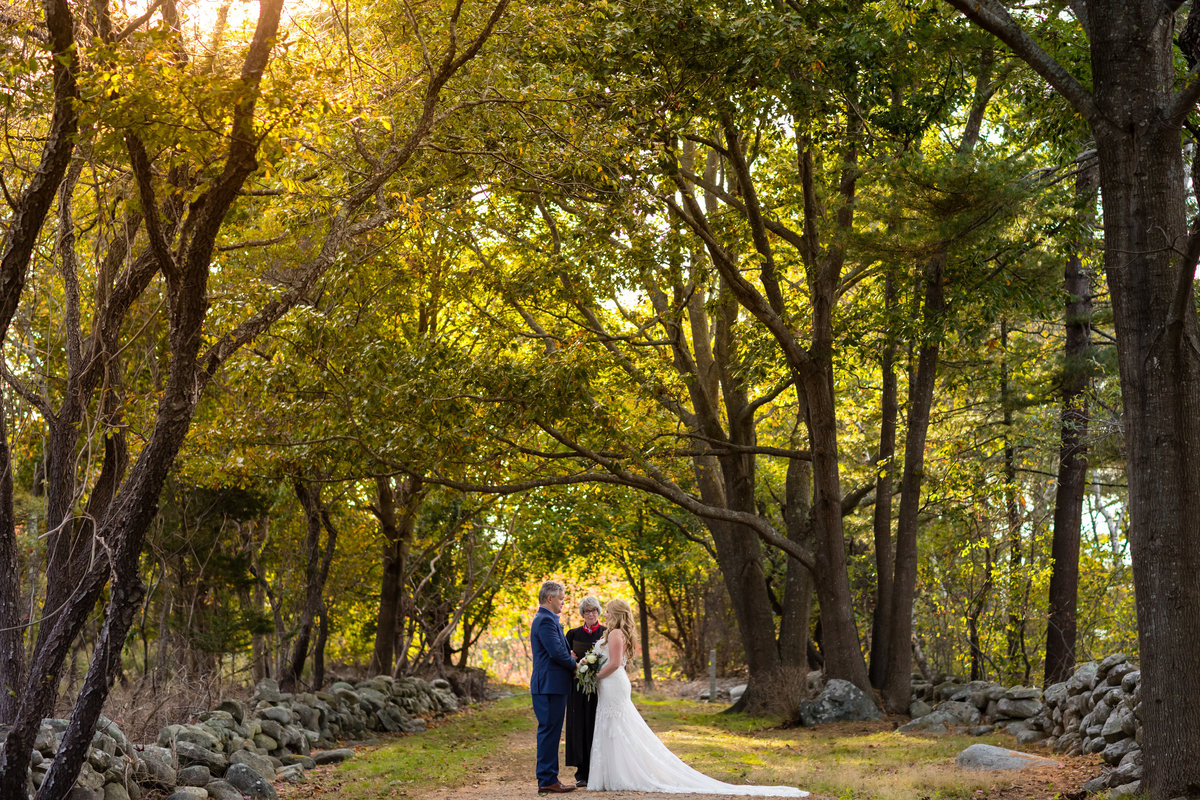 The arched tall trees at Odiorne Point Park serve as a backdrop for this NH elopement